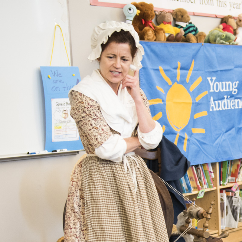 Nancy Bell performs a storytelling program about spinning and the American Revolution